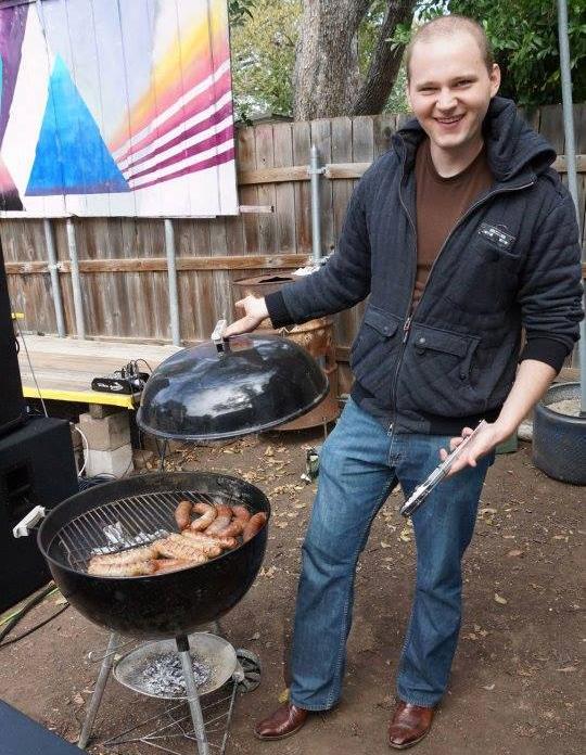 Keenan grilling sausages.
