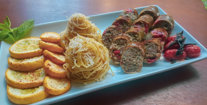 Pistachio Pesto Sausage served with capellini, roasted squash, and tomato.